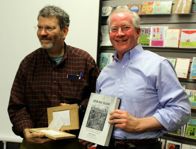 Professor Scott Denham (holding breadboard) and Timothy Boyce with book